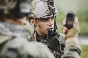 soldiers holding gps in hand and determines the location of coordinates